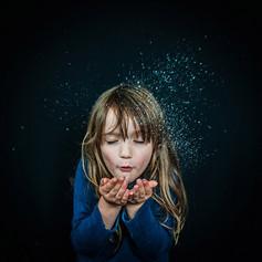 Girl Blowing Magic Dust