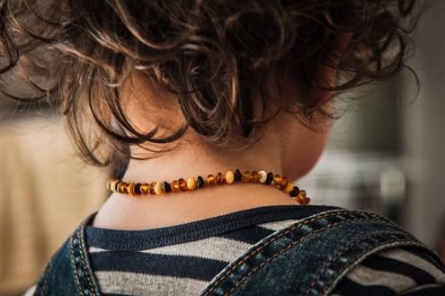 Boy wearing beads