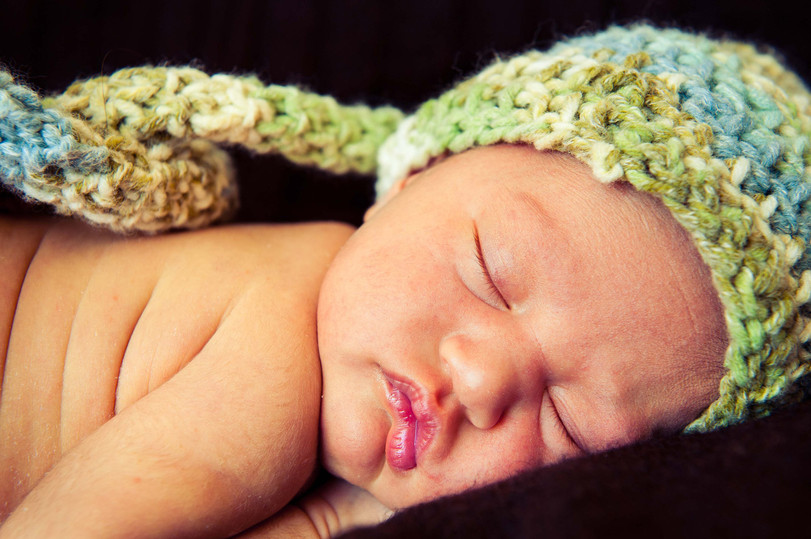 Baby with colourful crochet