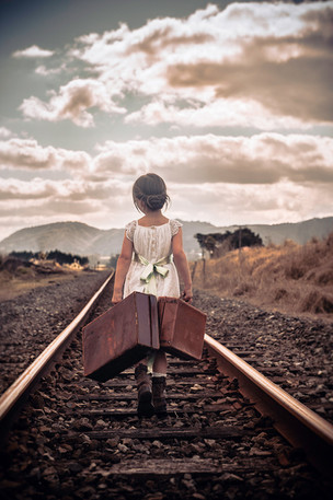 Girl walking on train tracks