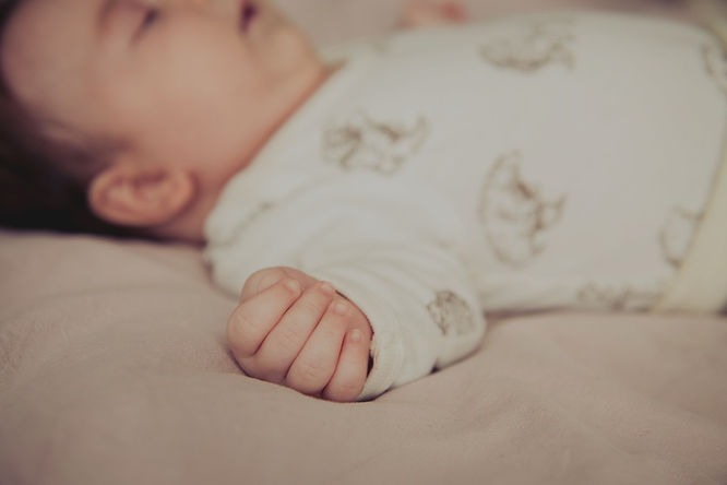 colour image of a newborn baby by family photographer Josie Gritten