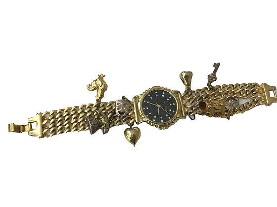 Reloj vintage con dijes