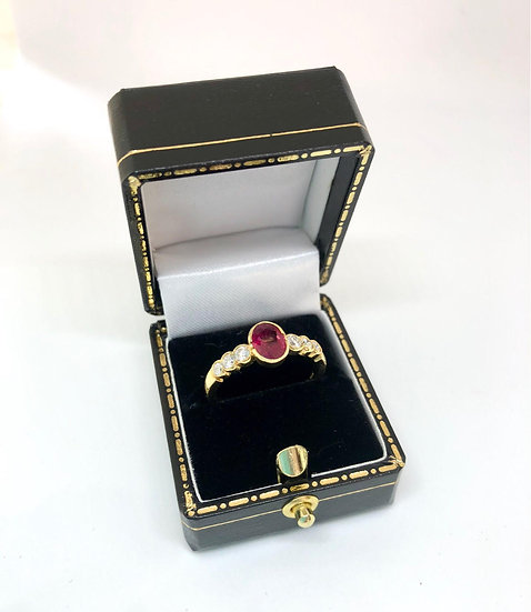 Oval Cut Ruby and Diamond Ring