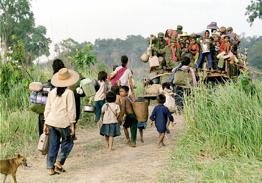 Khmer Rouge soldiers and families head to a refugee camp along the Thai-Cambodia border. 1998