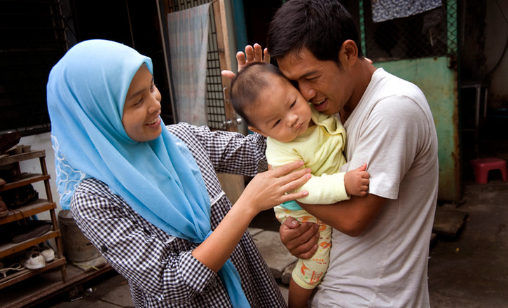 A family in Chiang Mai, Thailand with their son.