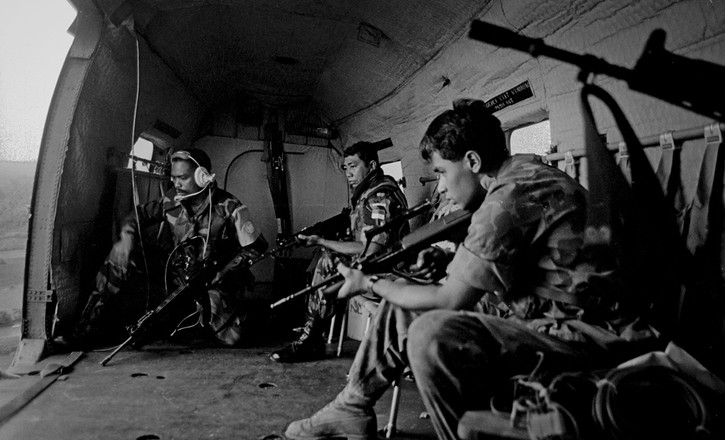 UN soldiers prepare to land at a pollig station in Kompong Thom during the national elections. 1993