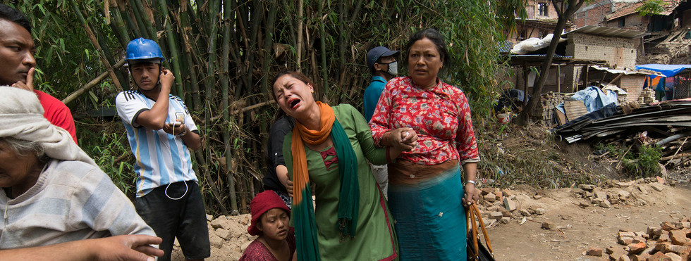 Sharmila Mali, is consoled by family members soon after a 7.3 earthqake in Lalitpur Bungamati. She was worried for her young son, who was in the city at the time of the quake. Shortly after he was re-united with her, unharmed.  2015