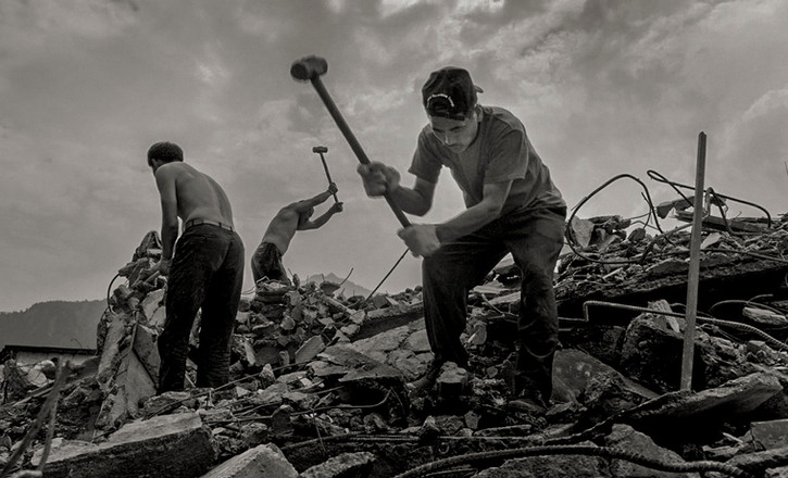 Villagers salvage metal in the aftermath of the 2008 earthquake. 2008