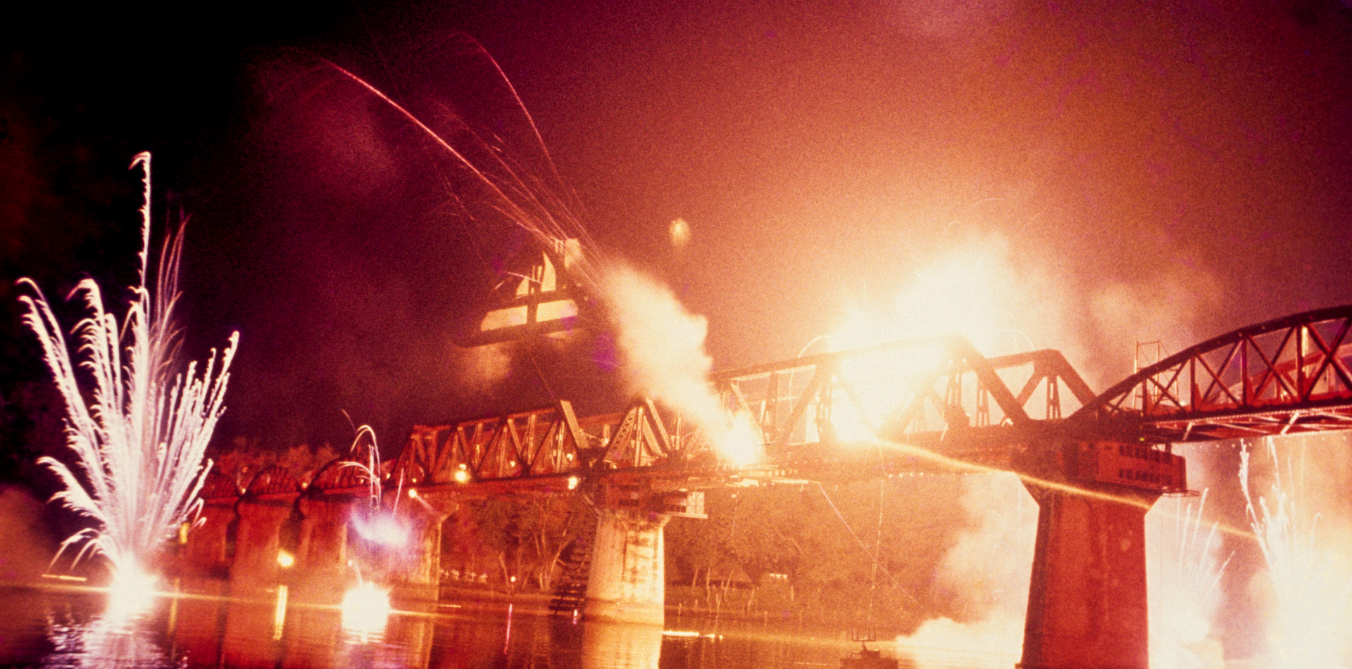 River Kwae, Thailand. Light and sound show depicting the bombing of the bridge in 1944/e