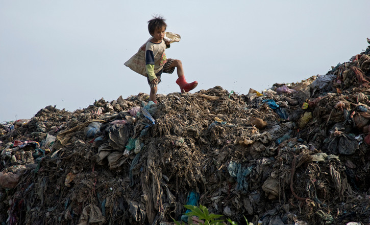 Seven year old boy at the dumpsite in Phnom Penh, Cambodia. 2008