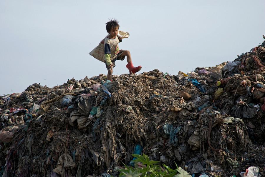 Seven year old boy at the dumpsite in Phnom Penh, Cambodia. 2008