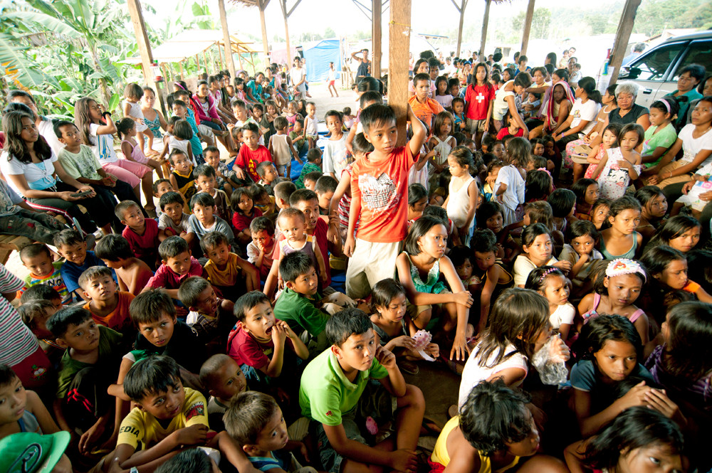 Children wait for gifts from Samaritan's Purse in a tent community of Calaanan, Cagayan de Oro, soon after the typhoon destroyed hundreds of homes. 2012
