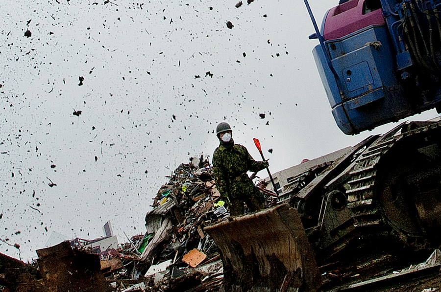 A Japanese soldier works on the tsunami cleanup near Ofunato, Japan. 2011