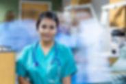 pretty-hispanic-nurse-standing-still-in-