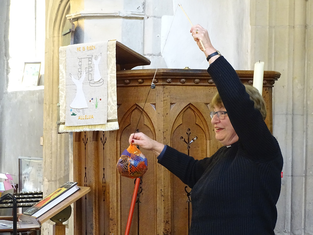 """The Rev Gill with her net of """"fish"""""""