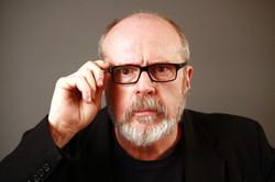 Rick Overton_Black Coat & Glasses