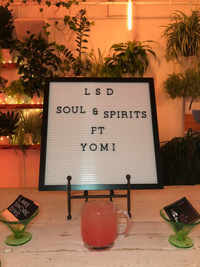 Yomí at Tapster sign with Summer Friends cocktail