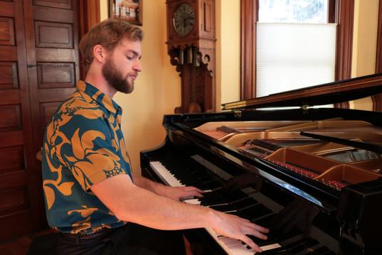 Adam playing piano amelia adjust 100 pc.