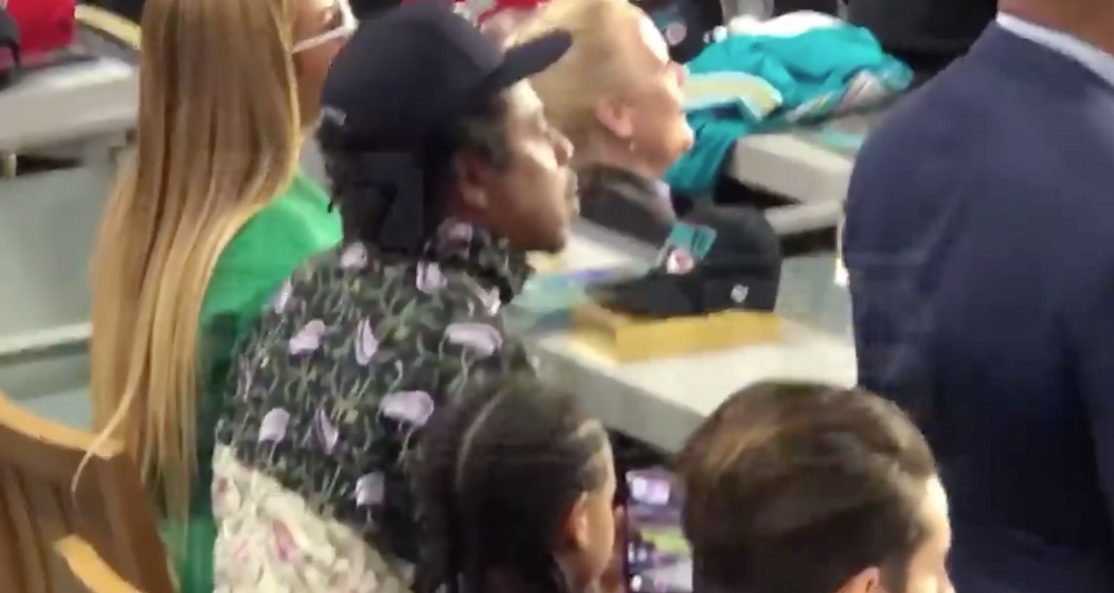 Beyonce and Jay Z sitting during National Anthem during Super Bowl