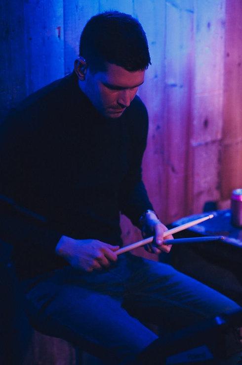 Joseph playing drums for Tragic Sasha at