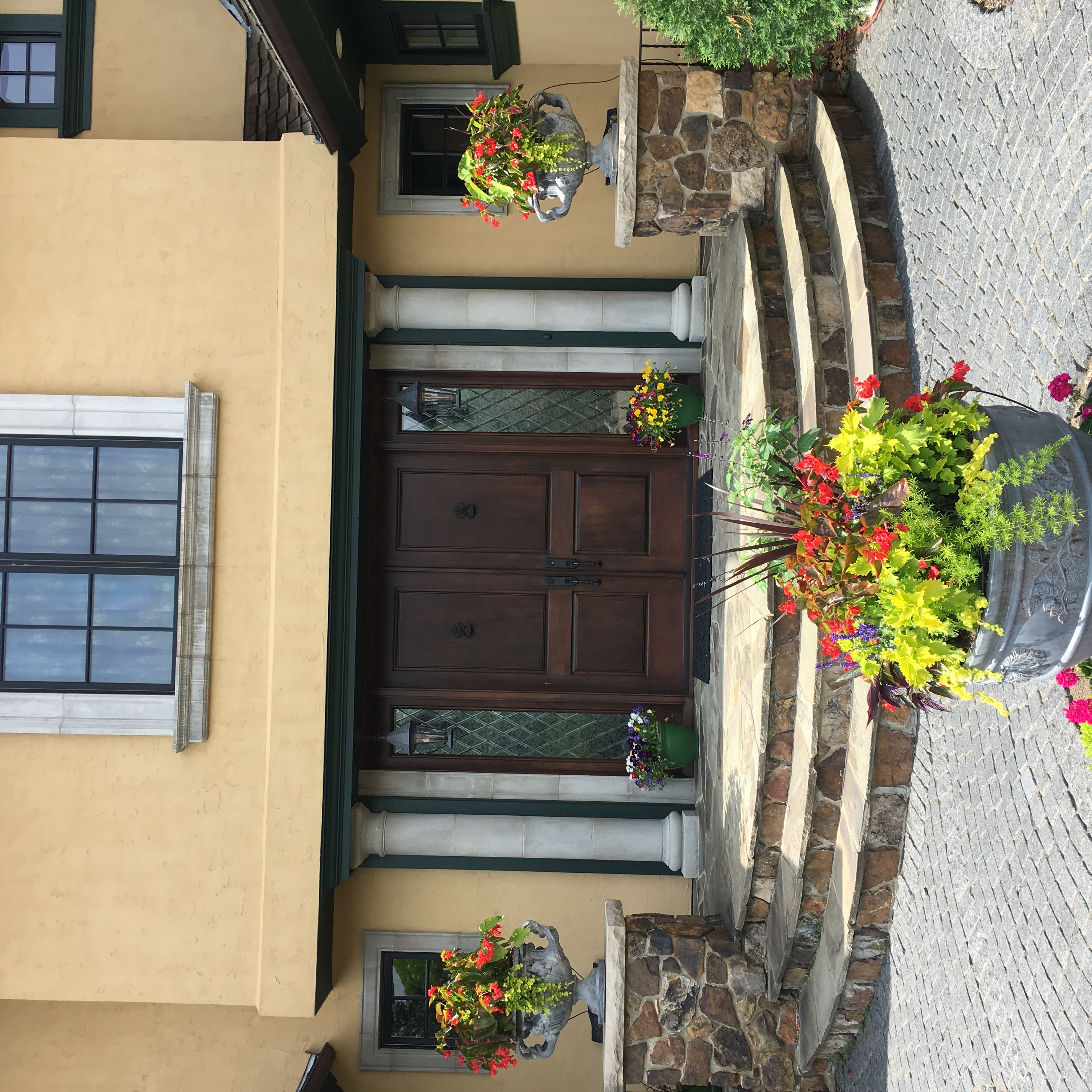 Beautiful front entrance planters.