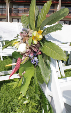 Flowers on aisle chairs