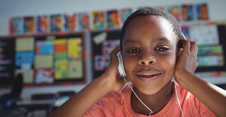 boy listening to audio stories.jpeg