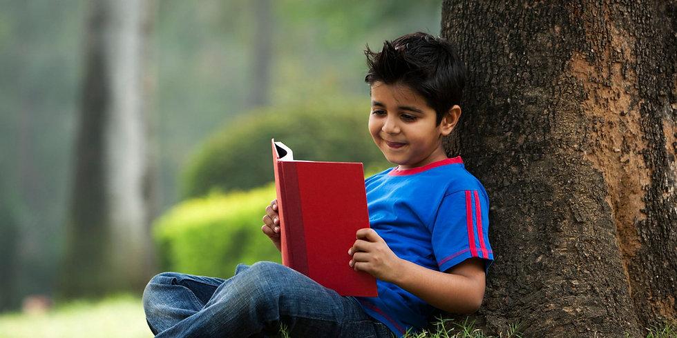 child-reading-under-tree.jpeg