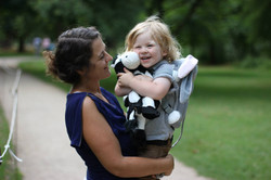 Mother holding kids with toddler backpack