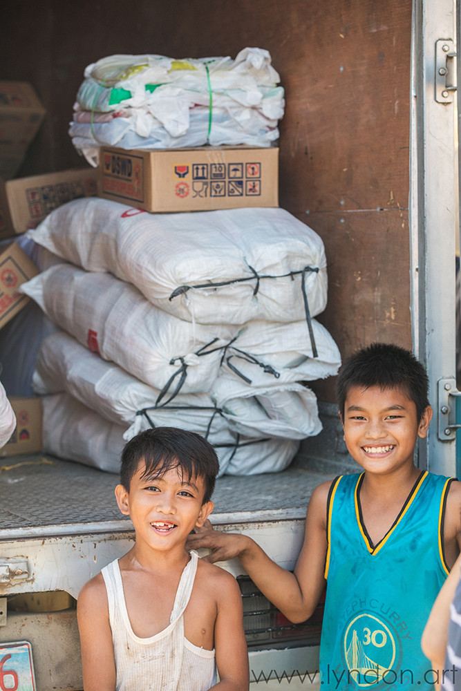 Relief supplies arrive with smiles.
