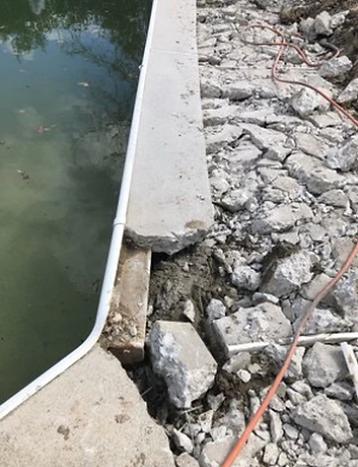Partial demolition of concrete pool deck