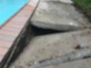 Sunken concrete slab posing a safety hazard