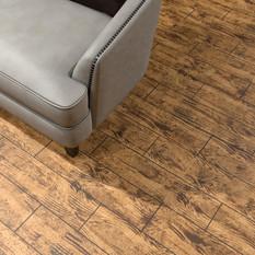 Brazilian Walnut RenuKrete ECF floor in basement with couch close-up