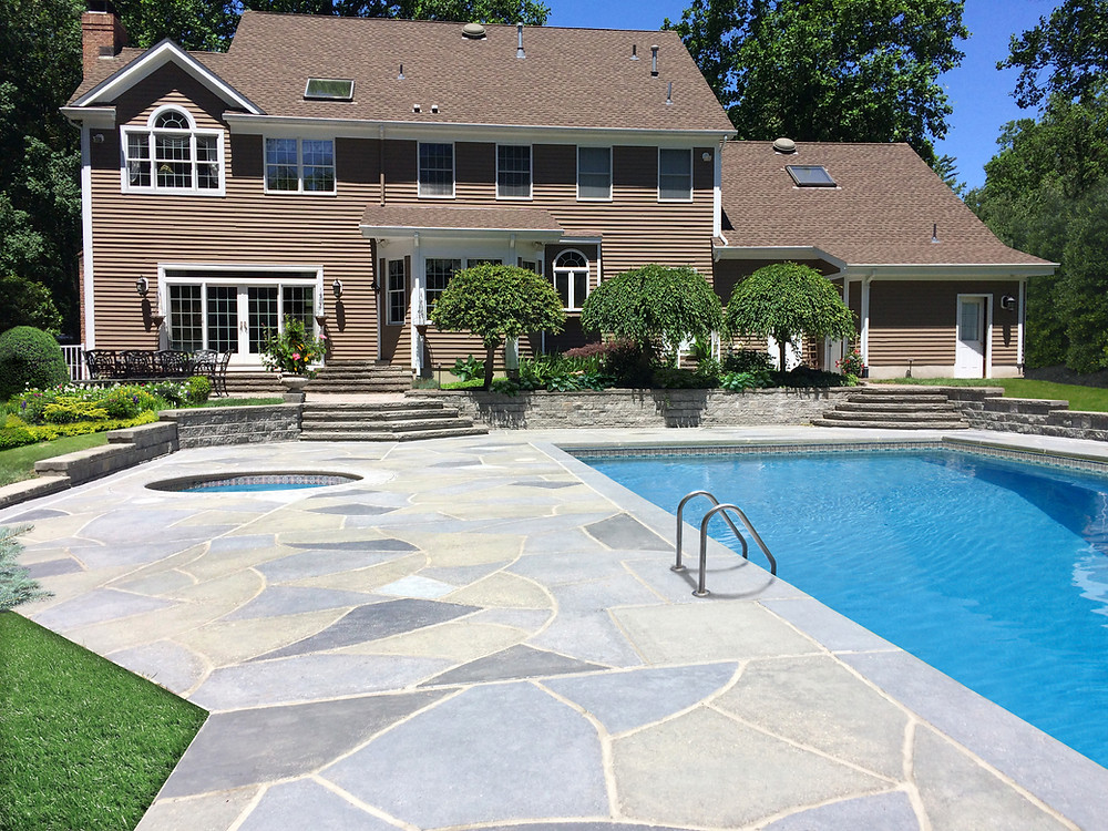 RenuKrete resurfaced this concrete pool deck to the look and feel of natural stone