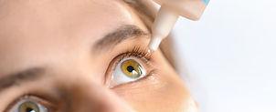 Woman applying eye drop. Vitamin drops f