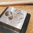 Deconstructed spinning ring