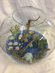 Vase, perles bleu,échéverias et décorations d'été