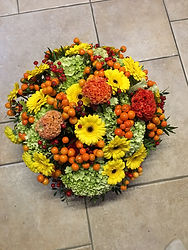 germini jaune, célosie orange,piment orange et hortensias vert