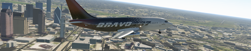 BRAVO 737-200 WITH DOWNTOWN DALLAS IN THE BACKGROUND
