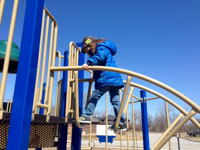 child playing on play structure.jpg