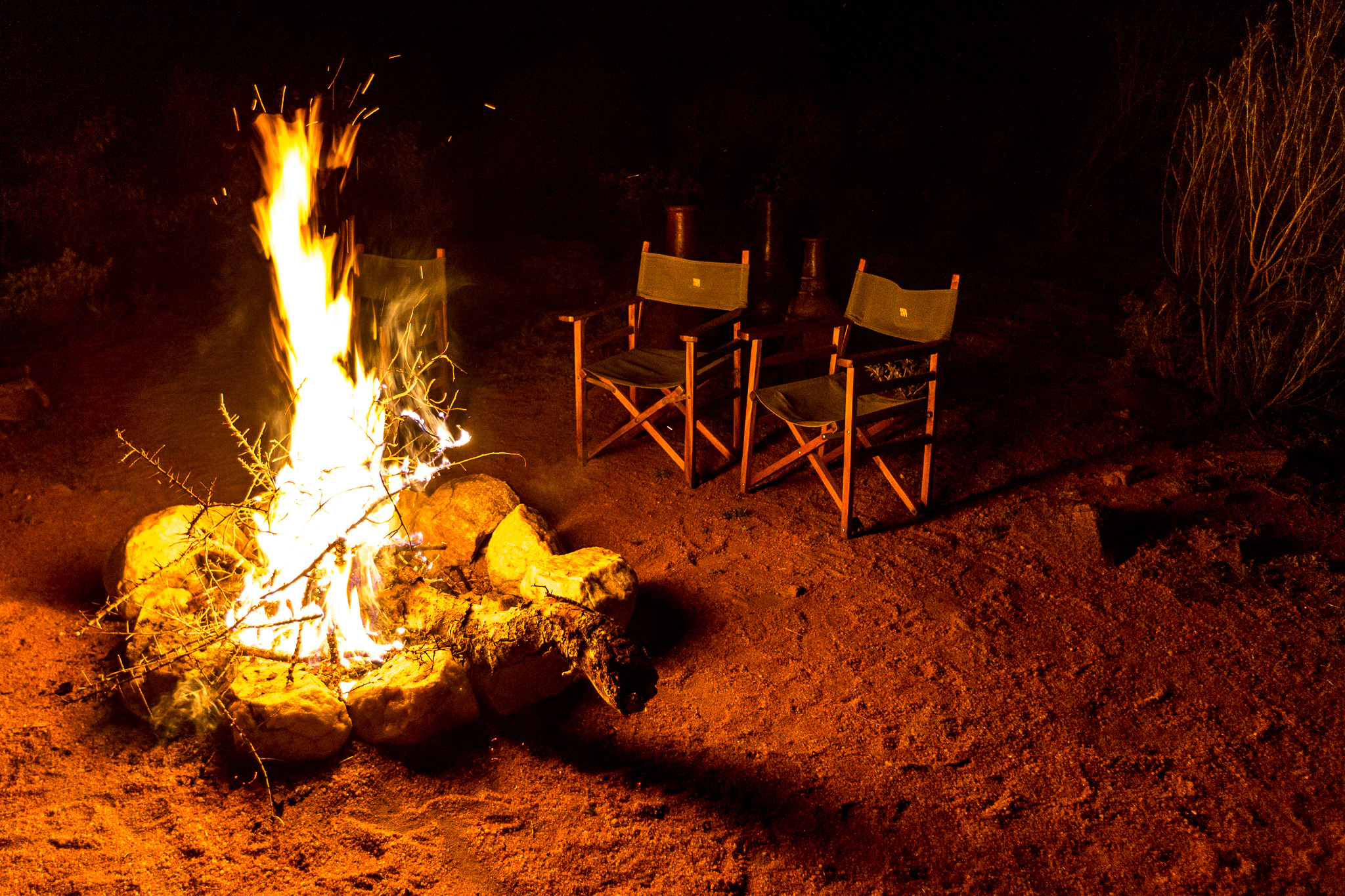 Evening story telling time round campfire at Maji Moto Eco Camp.