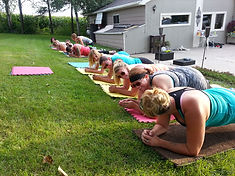 BACKYARD Bootcamp group plank exercise.