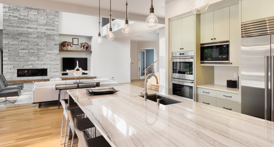 Kitchen with Island, Sink, And Cabinets