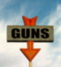 aged and worn vintage of gun shop sign.j