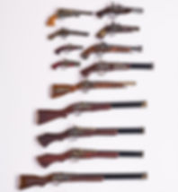 collection of ancient guns and pistols.j