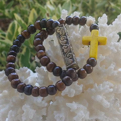 Brown beaded bracelet w Yellow Cross