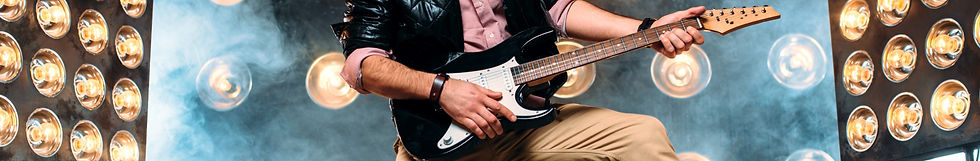 male-pop-star-with-electro-guitar-stage-