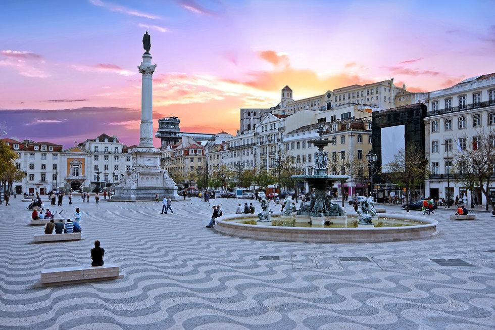 Rossio square in Lisbon Portugal at suns