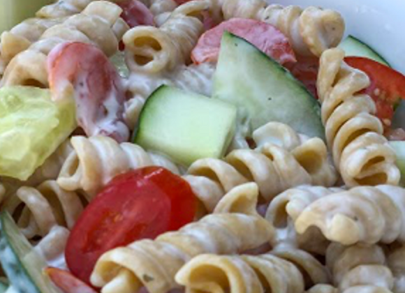 pasta salad with ranch, cucumbers, tomatoes and Parmesan cheese