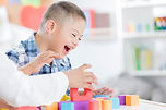 Special Needs child palying with blocks